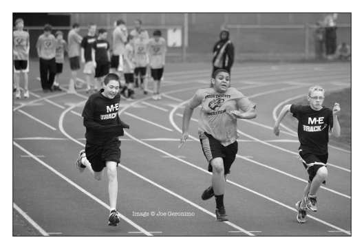 Michael (Left) in the 100 Meter Dash. Image © Joe Geronimo