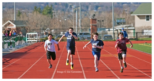 "Michael ""Second from Left"" i the 100M Dash, High Jump and Long Jump."
