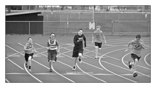Michael (Center) in the 200 Meter Dash. Image © Joe Geronimo