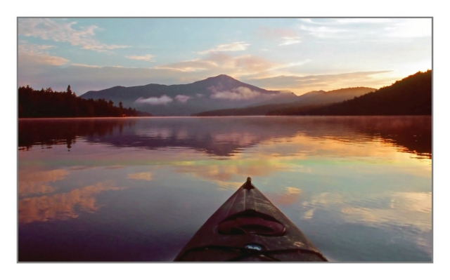 4,865 ft  Whiteface Mountain towers in the distance as the sun rises on Lake Placid in New York's Adirondack Park. Canon EOS 1N Fujichrome Provia 400X Image © Joe Geronimo.