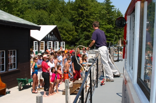 "US Mailboat ""Sophie C"" docks at 3 Mile Island on New Hampshire's Lake Winnipesaukee. Image © Joe Geronimo"