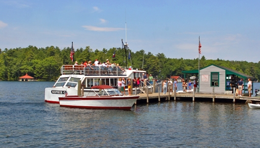 "US Mailboat ""Sophie C"" seen from Bear Island on Lake Winnipesaukee. Image © Joe Geronimo"