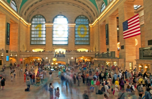 Travelers scurry the main concourse at Grand Central Terminal. Image © Joe Geronimo