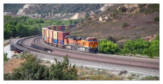 BNSF S-LBPLPC1-28A Long Beach to Logistics Park Chicago stacks #7110BNSFGE ES44C4 #4613BNSFGE Dash 9-44CW DPU #4573BNSFGE Dash 9-44CW #6931BNSFGE ES44C4 Image © Max Geronimo