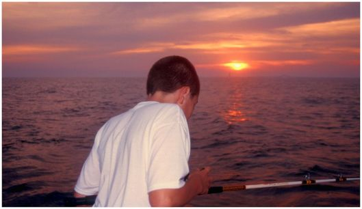 My son fishing on the Atlantic Ocean at sunset. Ektachrome 100 © Joe Geronimo