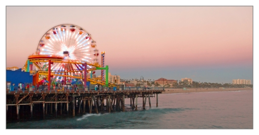 Santa Monica Pier and the Pacific Park at sunset Santa Monica, California June 25th 2013. Image © Joe Geronimo