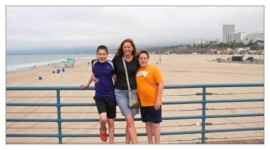 Julie and the boys on the pier in Santa Monica, California June 25th 2013. Image © Joe Geronimo