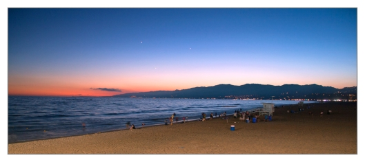 Sunset on Santa Monica beach looking north towards Malibu, Santa Monica, California June 25th 2013. Image © Joe Geronimo.
