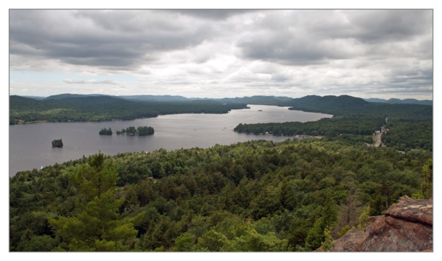 View of Fourth Lake from the summit of Rocky Mount looking south towards Eagle Bay. Image © Joe Geronimo