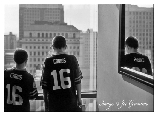 Our sons gazing out the 16th floor of the Crown Plaza Hotel in Cleveland, Ohio Kodachrome 64 Scanned & Converted.