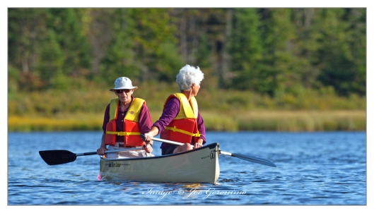This couple canoeing on Long Pond in Benton, New Hampshire really caught my attention. The red & yellow life jackets really popped in evening sun.