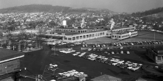 """Ranger/Paracord Factory adjacent to C.F.J. Park in Johnson City built in 1944 to produce footwear for the military. Locals referred to the new (and old) Paracord plant as the """"rubber mill."""" C.F.J. Park swimming pool at left of picture. The Pagoda Pump-house can be seen at the left of the photo is the only preserved structure from this entire factory complex which covered about 30 acres. The Gannett printing facility now occupies this site."""