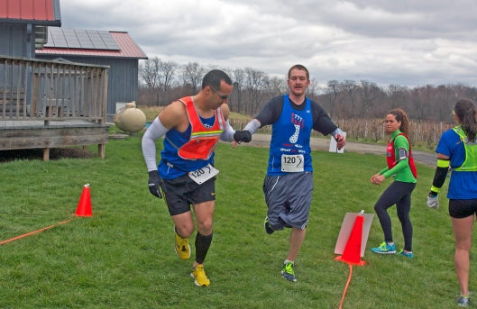Chris Strub hands off to James Wilson at Lakewood Vineyards milepost 33.1. Image © Joe Geronimo