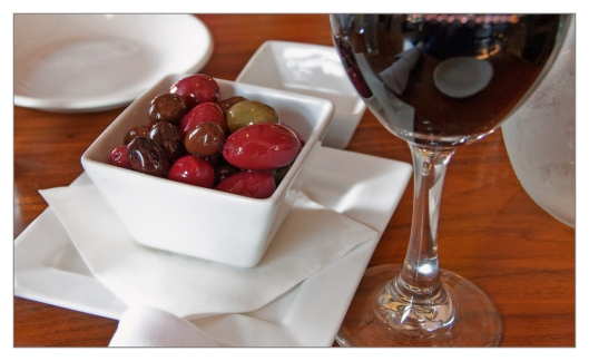 Marinated olives and a glass of Ryan William 2012 Merlot This velvety wine offers aromas of black currant with vivid minerality and ripe fruit flavors on the palate. It's the tannin structure inherent in Ryan William Vineyard that provides the lift in this Merlot that carries the dark fruit flavors.
