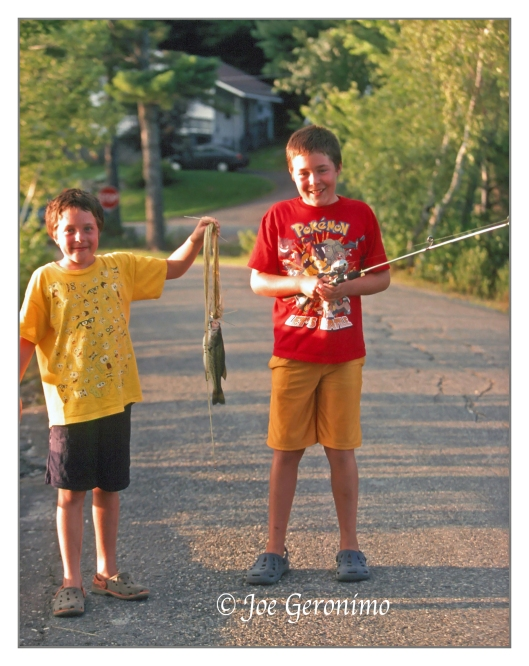 Michael & Max with their small mouth bass at North Pond in Greenwood Maine 2009. Kodachrome 64