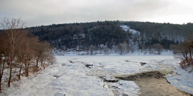 Crossing the frozen waters of the Lackawaxen River as it empties into the Delaware at Lackawaxen, PA.