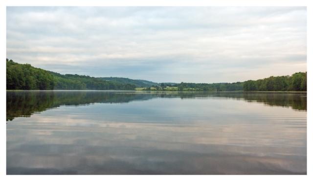The placid waters of Long Pond this morning. Image © Joe Geronimo 2015.