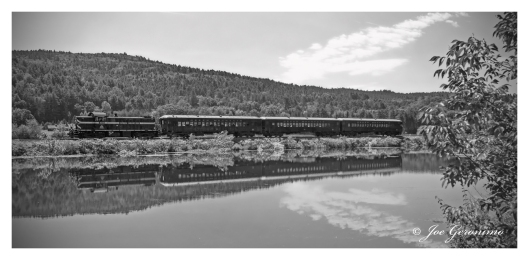 The Green Mountain Flyer makes its way along the Connecticut River just north of White River Jct. Vermont in August of 2010. Image © Joe Geronimo
