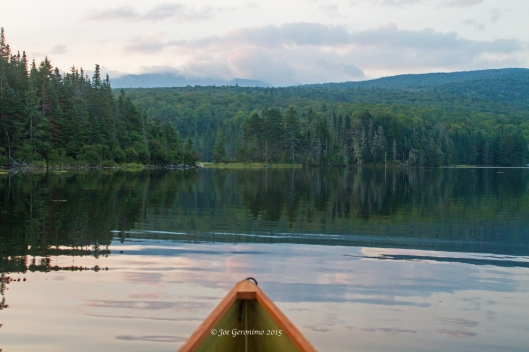 The placid waters of Long Pond in Benton, NH. Image © Joe Geronimo