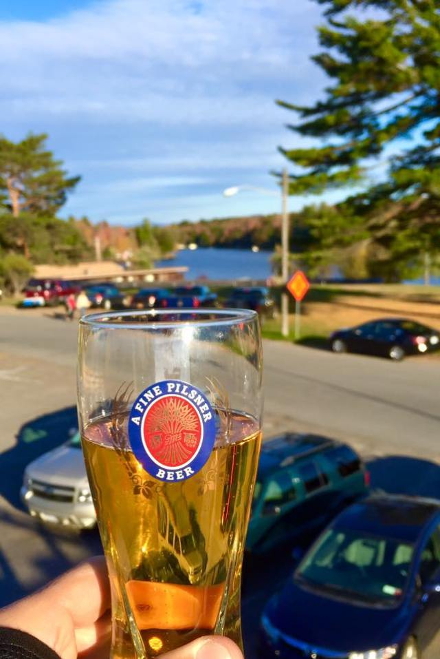 Enjoying a cold beer at the Back Door Bar in Old Forge, NY. © Joe Geronimo 2015