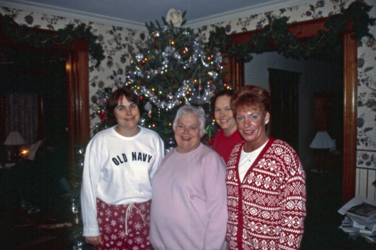 L-R: Julie's sister Christine, Mom, Julie and sister Beth Christmas Day 2003 in Michigan.