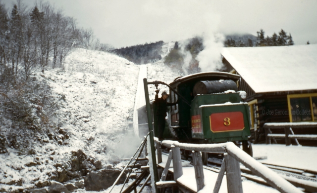 "In this winter scene Cog Railway #3 ""Agiocochook""  which was built in 1883 by the Manchester Locomotive Works is getting ready for a trip up the 6,289′ Mt. Washington."