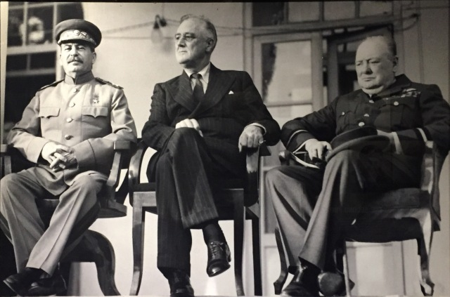 """The Tehran Conference"" On this day in 1943, President Franklin Delano Roosevelt joins British Prime Minister Winston Churchill and Soviet leader Joseph Stalin at a conference in Iran to discuss strategies for winning World War II and potential terms for a peace settlement."