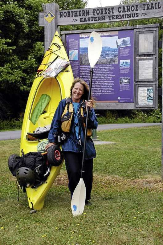 "Cathy Mumford, 50, seen here at the NFCT ""Eastern Terminus"" at Fort Kent, Maine. (Photo by Julia Bayly)"