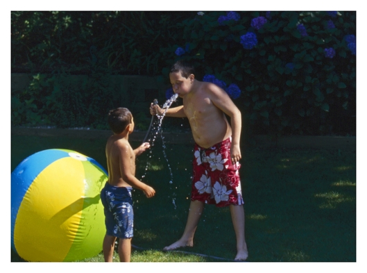My son Max, right, and my nephew Nicholas having some summer fun in July 2012. Image © Joe Geronimo Kodak Ektachrome 100.
