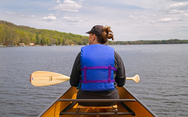 "Julie and I paddle ""Elsie"" on First Lake in Old Forge, NY. Image © Joe Geronimo"