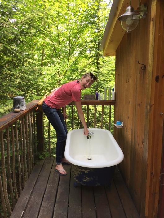 Kaye-Lani checking out the bathtub and outhouse.