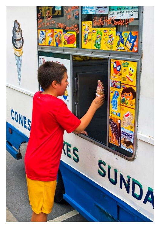 On the hot summer afternoon of August 22nd 2009, Michael has flagged down the Ice cream Man in Binghamton, NY. Image © Joe Geronimo
