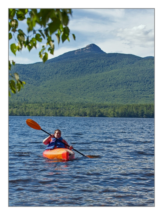 MAx paddles Chocorura lake in Tamworth, NH on July 10th 2014. © Joe Geronimo
