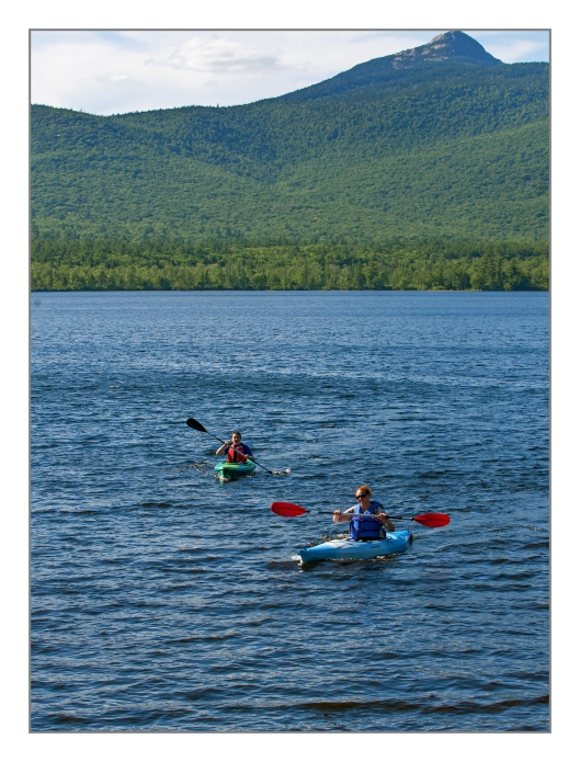 Julie & Michael paddle Chocorura lake in Tamworth, NH on July 10th 2014. © Joe Geronimo