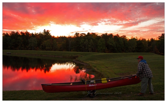 Don Welch wheels his canoe towards the shore of Nanticoke Lake October 12th 2016. Image © Joe Geronimo