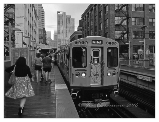 "The Chicago ""L"" July 15th 2016. You can notice walking ahead is Julie, Michael & Max. Agfa CT Precisa Slide Film, © Joe Geronimo"