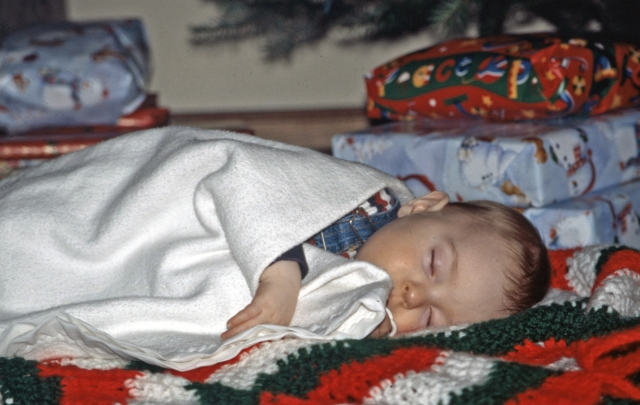 Max who used to just put himself down for a nap fell asleep under our Christmas tree. He was just 7 months in this December 2002 photo.